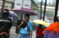 Tajfun zbli�a si� do Chin. Dziesi�tki tysi�cy os�b ewakuowanych