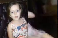 Syryjska dziewczynka �piewa piosenk� przed kamer�, gdy nagle eksploduje bomba